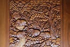 Photograph showing the craftsmanship of the teak wood table carving, no two tables are the same.