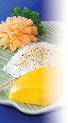 Photograph showing mango served on a bed of sweet sticky rice topped with coconut milk.